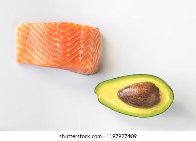 Raw salmon and avocado on the white background