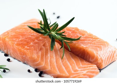 Raw salmon filet on dark slate background, wild atlantic fish