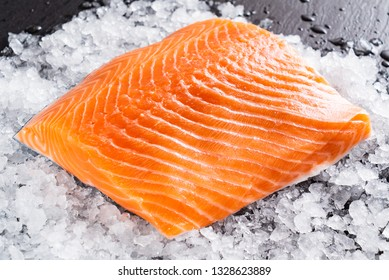 Raw salmon filet on the ice