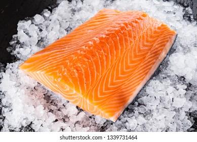 Raw salmon filet on the ice