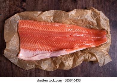 Raw salmon fillet on kitchen paper