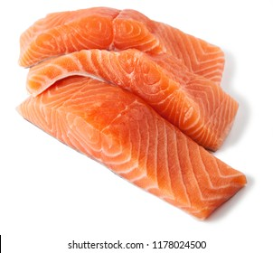 Raw salmon fillet slices, isolated on a white background.