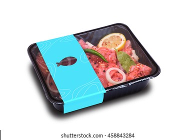 raw salmon with lemon and spices in the package. isolated on white background