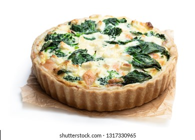 Raw salmon  quiche wich broccoli and spinach isolated on white