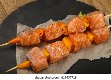 Raw salmon skewer with spices ready for cooking