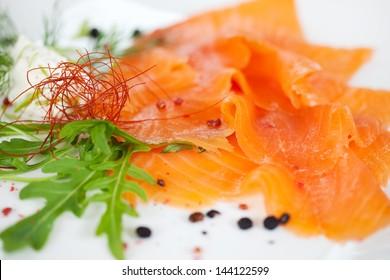 raw salmon slices dish at fish restaurant
