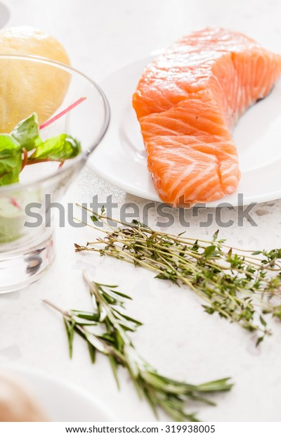 Raw salmon steak with herbs
