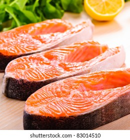 Raw salmon steak in row, prepared for cooking