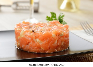 Raw salmon tartare with mixed vegetables
