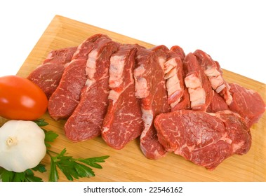 Raw Scotch Fillet Steak on wooden board over white background