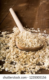 raw scottish oatmeal and a wooden spoon
