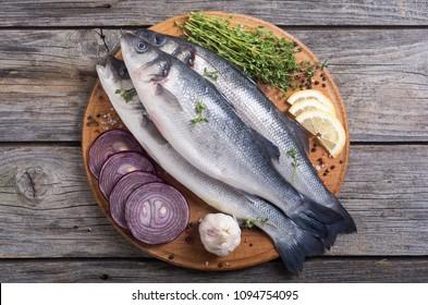 Raw sea bass fish . Cooking fresh seabass