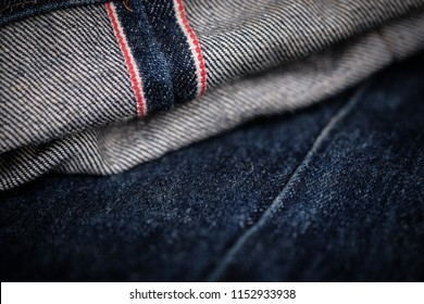 Raw Selvedge Denim Blue Jeans Rolled and Close Up.