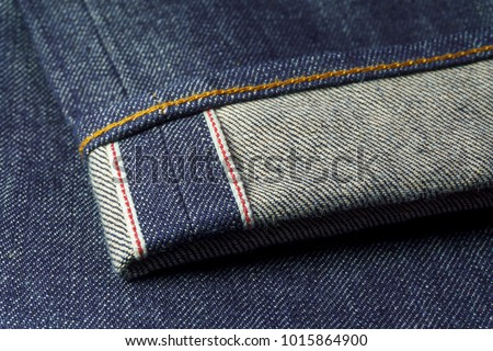 Raw Selvedge Denim Blue Jeans Rolled and Close Up