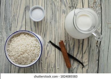 Raw short grain rice, milk, sugar, cinnamon sticks and vanilla pod