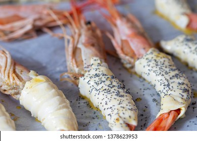 Raw shrimps in crust with poppy seeds.