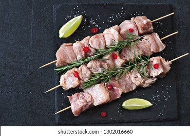 Raw skewers on a stone board. Cooking barbecue.