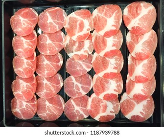 Raw sliced red pork ;the ingredient for grilled barbecue, in the tray