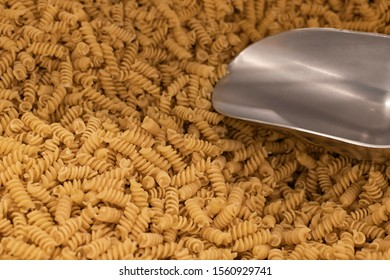 raw spaghetti supermarket counter background with metallic weight spoon