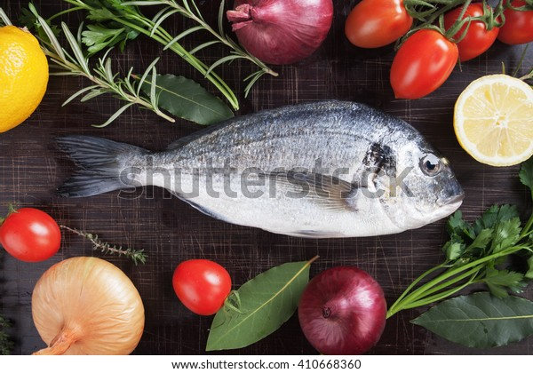 Raw Sparus Aurata or gilt-head bream fish ready for cooking