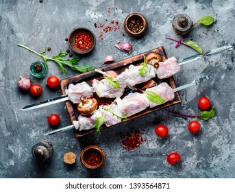 Raw spicy meat shish kebab on a cutting board.Skewer set of meat