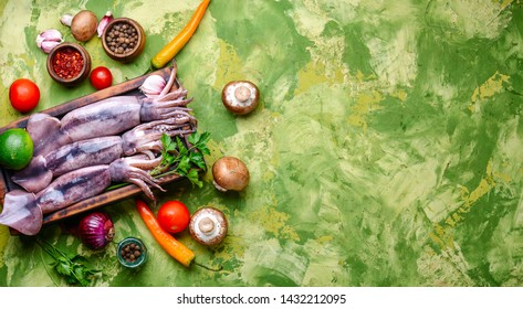 Raw squid on the kitchen board.Seafood.Fresh raw whole squid
