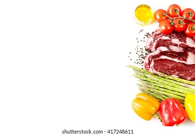 Raw steak with vegetables and spices isolated on white with copy space