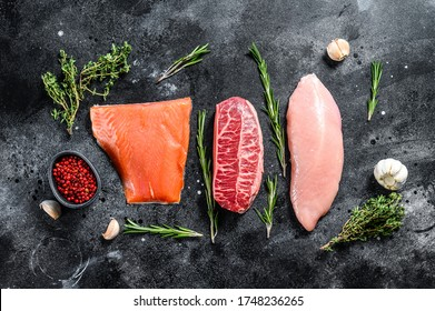 Raw steaks. Beef top blade, salmon fillet and Turkey breast. Organic fish, poultry and beef meat. Black background. Top view