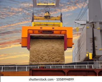 Raw sugar bulk is loading in hold's vessel by roll trainer.