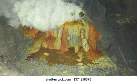 Raw sulfur mining in the crater of Kawah Ijen active volcano on Java. Miners build volcanoes from which hot sulfur flows and then solidifies.