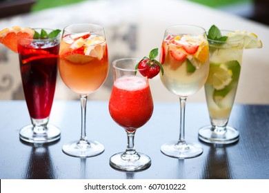 Raw of summer cocktails on a black table