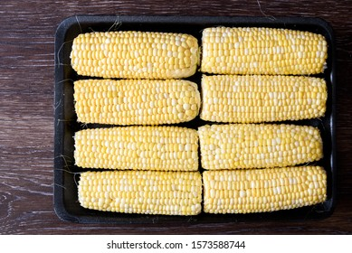 Raw sweet corn shucked and ready to cook