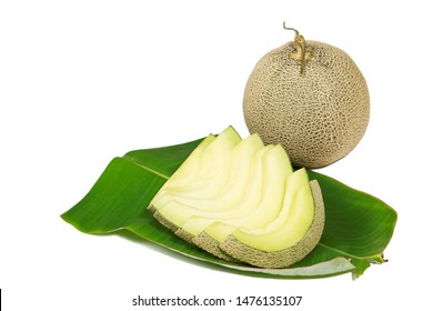 raw and sweet green cantaloupe on banana leave with clipping path, isolated cantaloupe melon