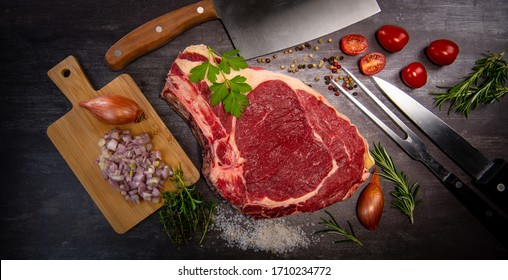 Raw T Bone steak entrecote prepared to Grill on turntable
