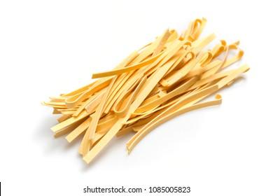 raw tagliatelle macaroni isolated on a white background