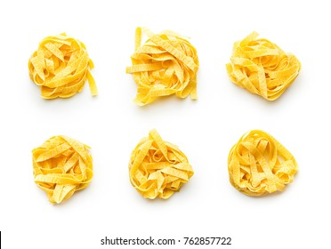 Raw tagliatelle pasta isolated on white background.