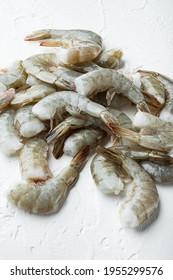 Raw tiger prawns set, on white stone surface