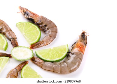 Raw tiger shrimps on plate. Isolated on a white background.