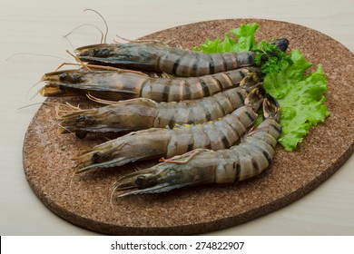 Raw tiger shrimps on the wood board