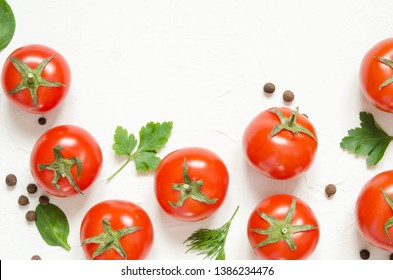 Raw tomatoes, herbs and black pepper on a light concrete background. Top view with copy space. - Image