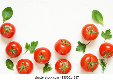 Raw tomatoes, herbs on a light concrete background. Top view with copy space. - Image