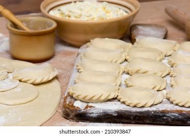 Raw traditional Ukrainian hand-made varenyky (dumplings) (pierogi ruskie in Poland) with cottage cheese