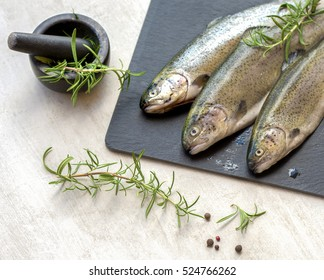 Raw trout on  gray board ready for cooking - Shutterstock ID 524766262