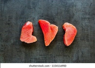 Raw Tuna fish steaks on vintage background flat lay. Healthy cooking. Food concept. Top view