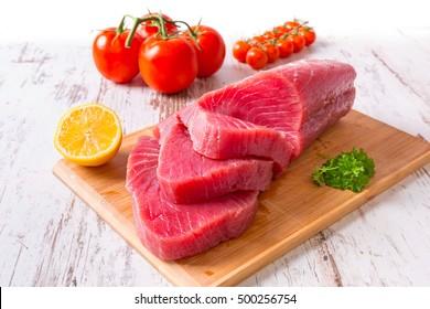 Raw tuna steak on wooden cutboard