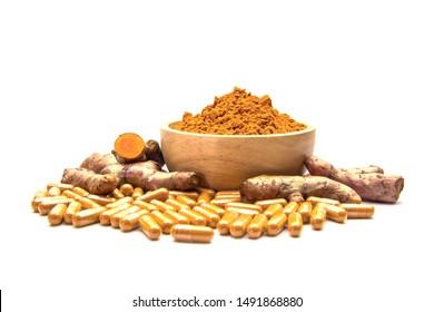 Raw Turmeric (Curcuma longa Linn) herbal,curcuma powder in wooden cup and turmeric capsules isolated on white Background.