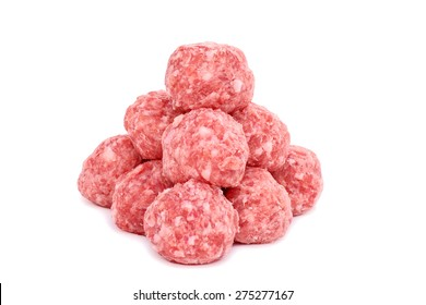 Raw uncooked meatballs on a isolated white