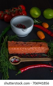Raw uncooked salmon fish with vegetables and spices. Healthy dinner.