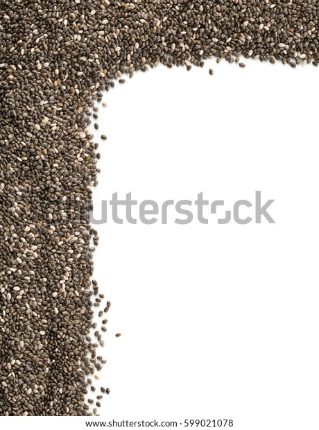 Raw unprocessed whole dried black chia seed corner edge on white background