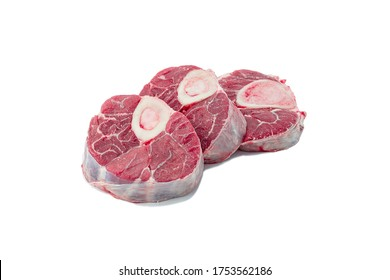 raw veal meat with marrow bone for italian dish Osso Buco cutout on white background